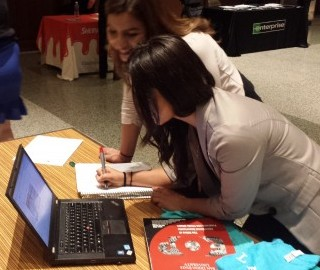 Students from SDSU AMA Mixer Jasmine and Nayeli add website suggestions.